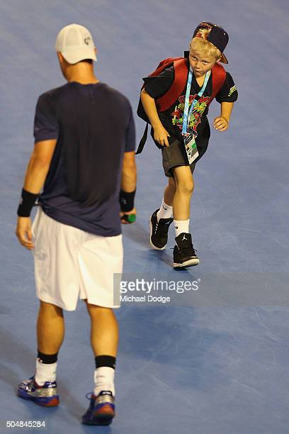 Lleyton Hewitt of Australia has his son Cruz Hewitt run by while he is hitting during a practice session ahead of the 2016 Australian Open at...