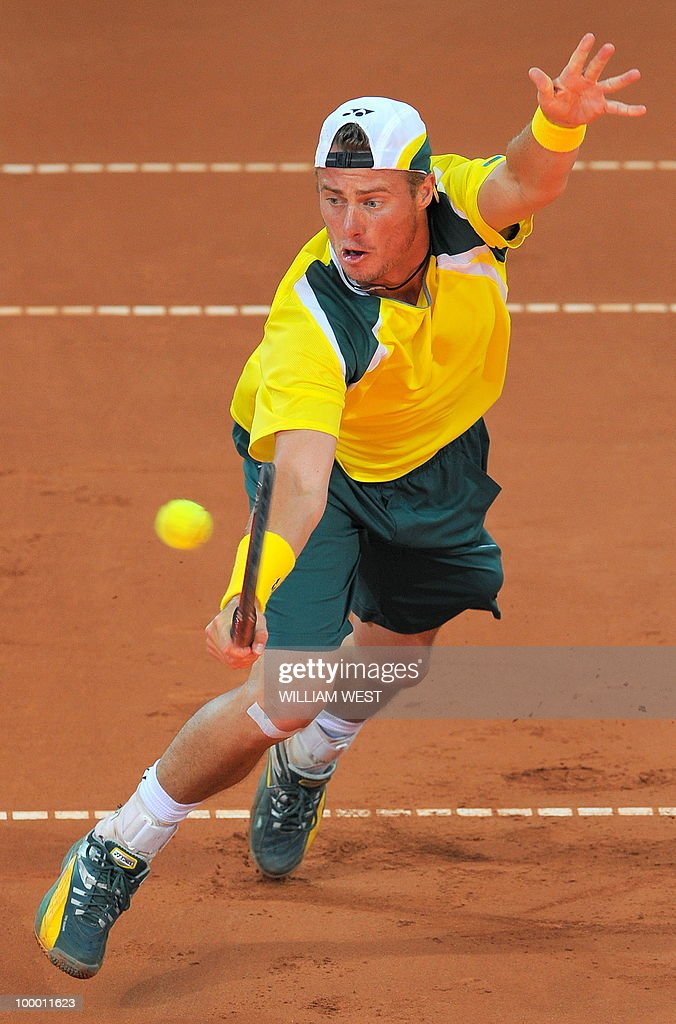 Lleyton Hewitt of Australia hits a backhand volley in his match against Tatsuma Ito of Japan during their Davis Cup tennis tie played in Brisbane on May 7, 2010. RESTRICTED TO EDITORIAL USE � NO ADVERTISING USE - NO PROMOTIONAL USE � NO MERCHANDISING USE AFP PHOTO/William WEST