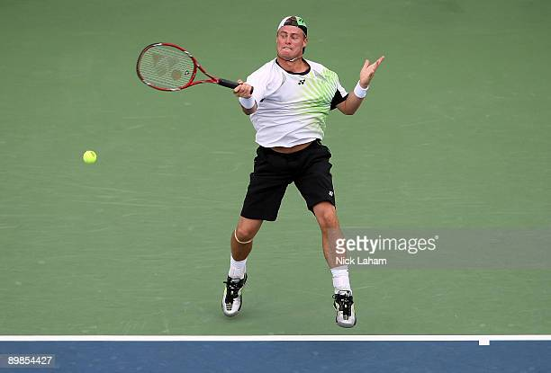 Lleyton Hewitt of Australia hits a forehand against Robin Soderling of Sweden during day two of the Western Southern Financial Group Masters on...