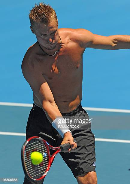 Lleyton Hewitt of Australia hits a return during a practice session in the leadup to the Australian Open tennis tournament in Melbourne on January 16...