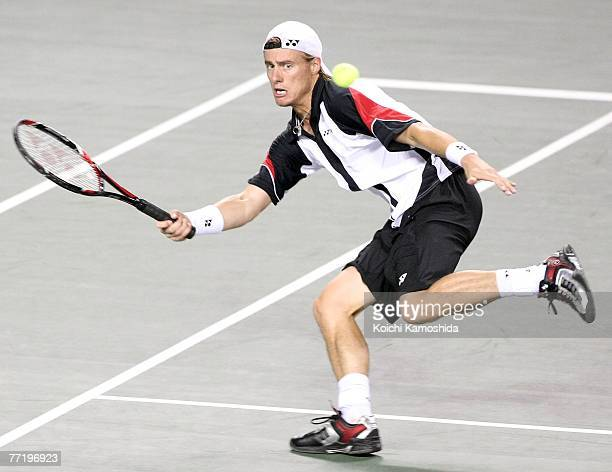Lleyton Hewitt of Australia hits a return shot against Ivo Karlovic of Croatia during Day 5 of the AIG Japan Open Tennis Championships held at Ariake...