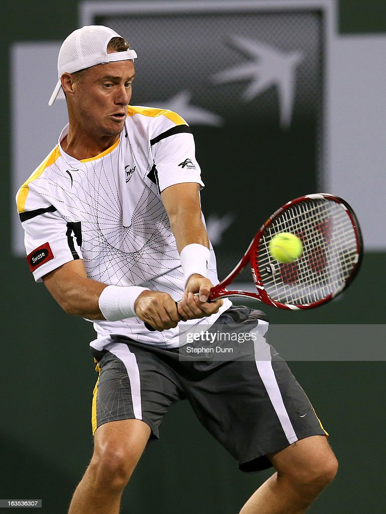 Lleyton Hewitt of Australia hits a return to Stanislas Wawrinka of Switzerland during day 6 of the BNP Paribas Open at Indian Wells Tennis Garden on March 11, 2013 in Indian Wells, California. (Photo by Stephen Dunn/Getty Images).