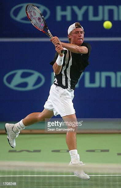 Lleyton Hewitt of Australia in action against Dominik Hrbaty of the Slovak Republic during the 2002/2003 Hyundai Hopman Cup at the Perth Superdome in...