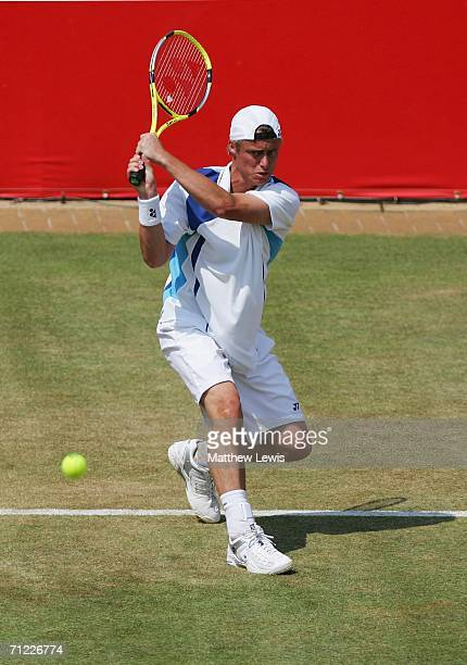 Lleyton Hewitt of Australia in action against Tim Henman of Great Britain during Day 6 of the Stella Artois Championships at Queen's Club on June 17,...