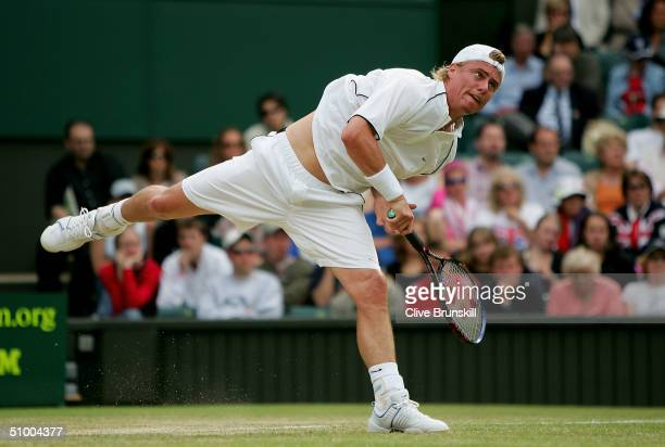 Lleyton Hewitt of Australia in action during his fourth round match against Carlos Moya of Spain at the Wimbledon Lawn Tennis Championship on June 28...
