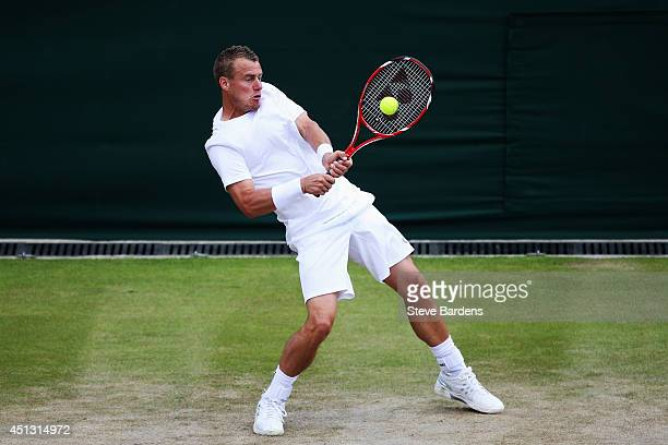 Lleyton Hewitt of Australia in action during his Gentlemen's Singles second round match against Jerzy Janowicz of Poland on day five of the Wimbledon...