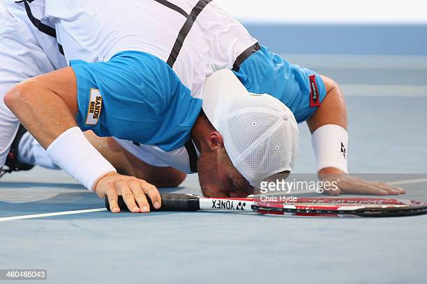 Lleyton Hewitt of Australia kisses the ground after winning his semi final match against Kei Nishikori of Japan during day seven of the 2014 Brisbane...