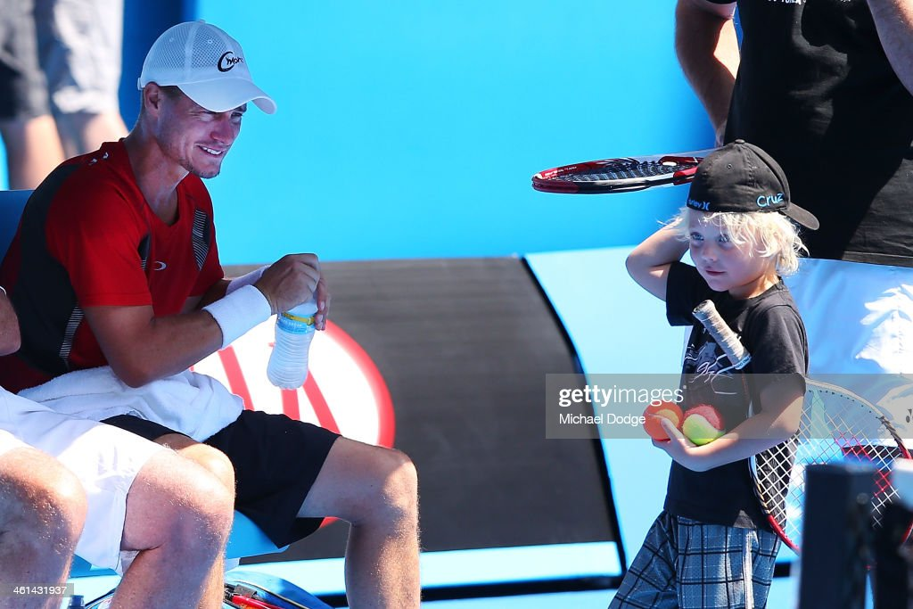 Lleyton Hewitt of Australia looks at his son Cruz Hewitt during his training session ahead of the 2014 Australian Open at Melbourne Park on January 9, 2014 in Melbourne, Australia.