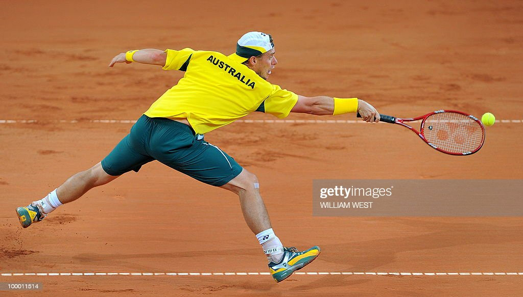 Lleyton Hewitt of Australia lunges for the ball in his match against Tatsuma Ito of Japan during their Davis Cup tennis tie played in Brisbane on May 7, 2010. RESTRICTED TO EDITORIAL USE � NO ADVERTISING USE - NO PROMOTIONAL USE � NO MERCHANDISING USE AFP PHOTO/William WEST