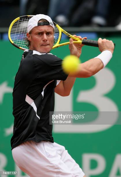 Lleyton Hewitt of Australia plays a backhand against Oscar Hernandez of Spain in their first round match during the ATP Masters Series at the Foro...
