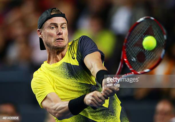 Lleyton Hewitt of Australia plays a backhand against Roger Federer of Switzerland during their match at Qantas Credit Union Arena on January 12 2015...