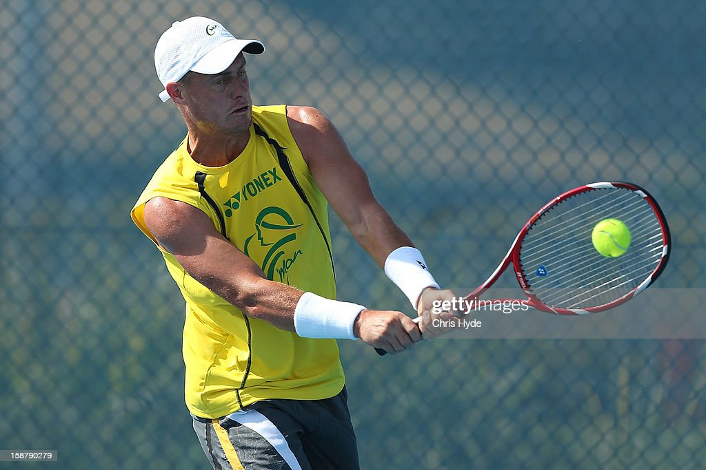 Lleyton Hewitt of Australia plays a backhand during a practice session at Pat Rafter Arena on December 29, 2012 in Brisbane, Australia.
