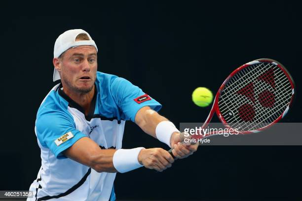 Lleyton Hewitt of Australia plays a backhand in his match against Marius Copil of Romania during day six of the 2014 Brisbane International at...