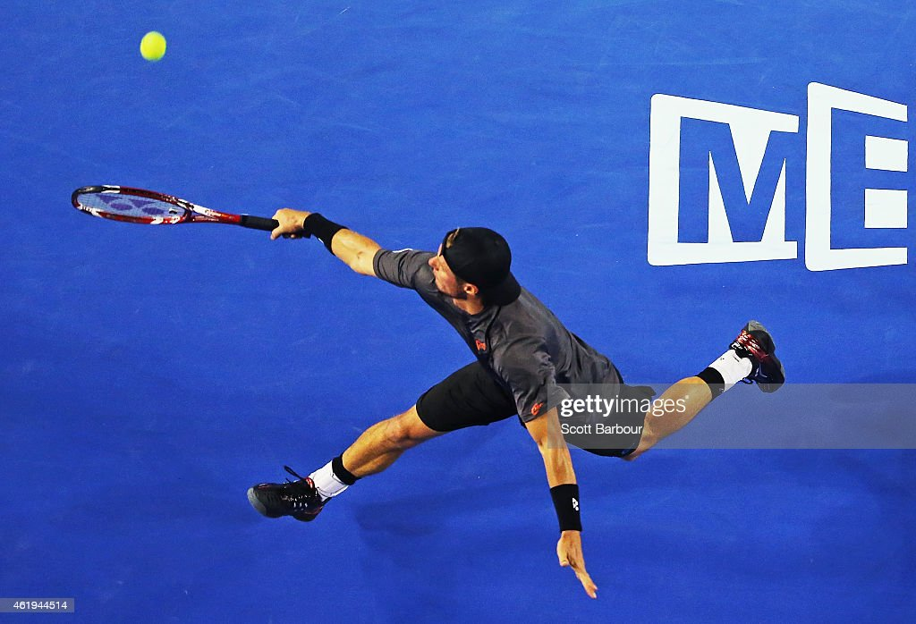 Lleyton Hewitt of Australia plays a backhand in his second round match against Benjamin Becker of Germany during day four of the 2015 Australian Open at Melbourne Park on January 22, 2015 in Melbourne, Australia.