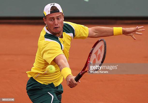 Lleyton Hewitt of Australia plays a backhand volley during his match against Yuichi Sugita of Japan during the match between Australia and Japan on...