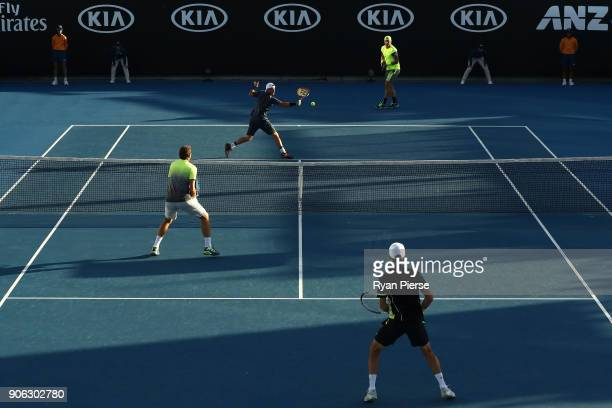 Lleyton Hewitt of Australia plays a backhand with in his first round men's doubles match Sam Groth of Australia against Denis Istomin of Uzbekistan...