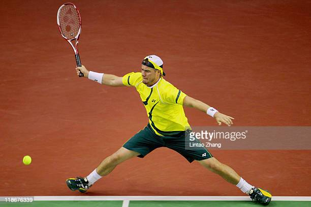 Lleyton Hewitt of Australia plays a forehand against Zhang Ze of China during day Three of the 2011 Davis Cup on July 10 2011 in Beijing China