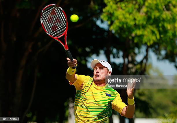 Lleyton Hewitt of Australia plays a forehand as Sam Groth and Lleyton Hewitt of Australia play Andrey Golubev and Aleksandr Nedovyesov of Kazakhstan...