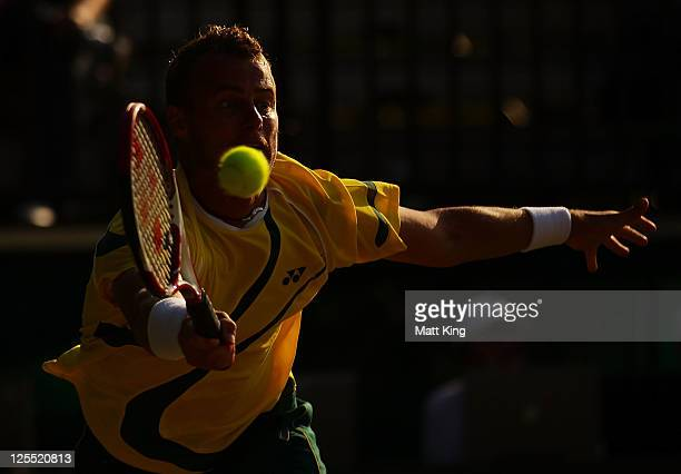 Lleyton Hewitt of Australia plays a forehand in his Davis Cup World Group Playoff Tie match against Stanislas Wawrinka of Switzerland at Royal Sydney...