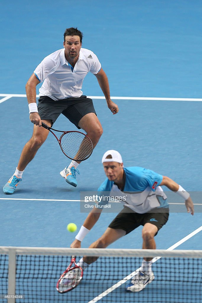 Lleyton Hewitt of Australia plays a forehand in his first round doubles match with Patrick Rafter of Australia against Eric Butorac of the United States and Raven Klaasen of South Africa during day three of the 2014 Australian Open at Melbourne Park on January 15, 2014 in Melbourne, Australia.