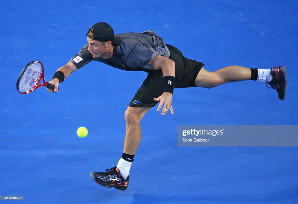 Lleyton Hewitt of Australia plays a forehand in his second round match against Benjamin Becker of Germany during day four of the 2015 Australian Open at Melbourne Park on January 22, 2015 in Melbourne, Australia.