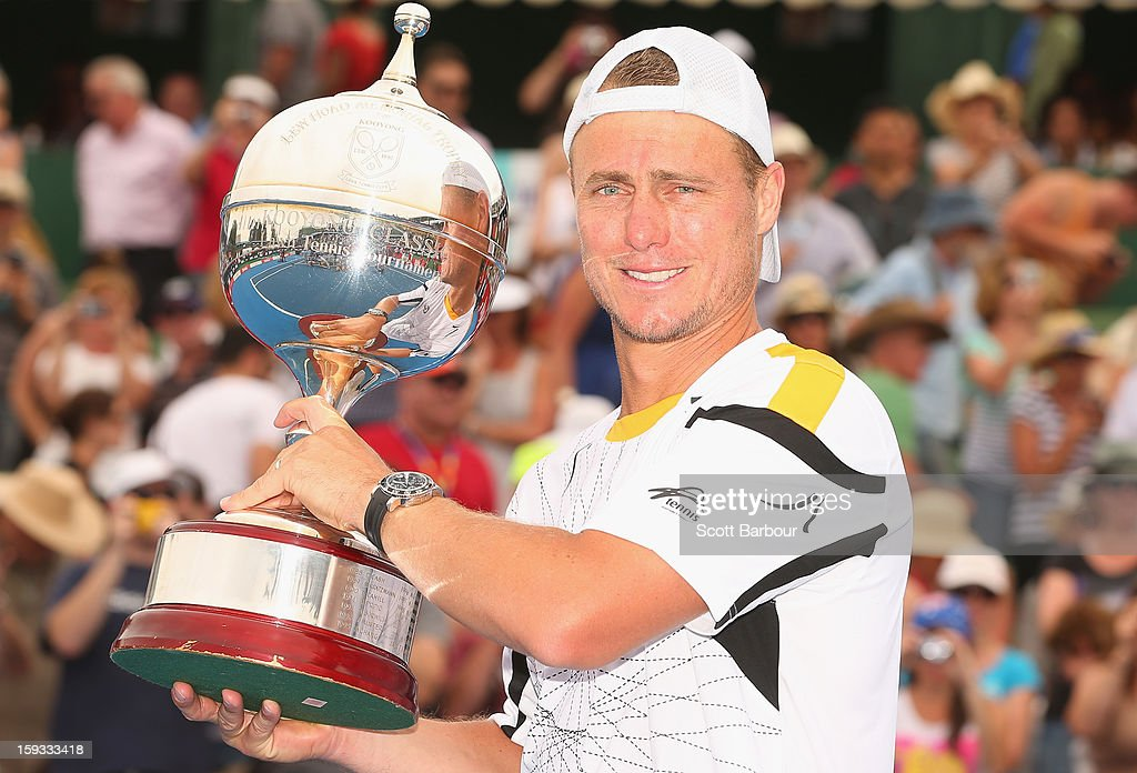 Lleyton Hewitt of Australia poses with the winners trophy after winning his match against Juan Martín del Potro of Argentina during day four of the AAMI Classic at Kooyong on January 12, 2013 in Melbourne, Australia.