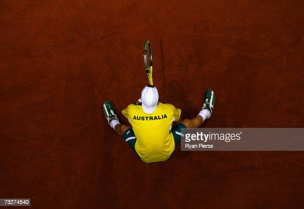 Lleyton Hewitt of Australia prepares to return serve during his match against Kristof Vliegen of Belgium during day one of the Davis Cup World Group...