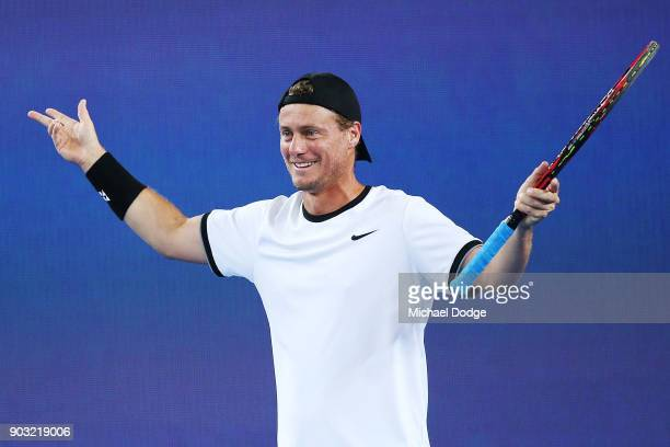 Lleyton Hewitt of Australia reacts at hearing the Adelaide Crows theme song during the Tie Break Tens ahead of the 2018 Australian Open at Margaret...
