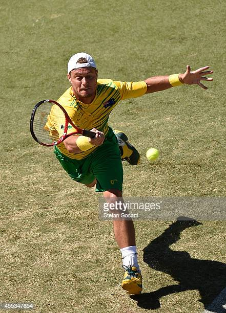 Lleyton Hewitt of Australia returns a shot in his doubles match with Chris Guccione against Denis Istomin and Farrukh Dustov of Uzbekistan during the...