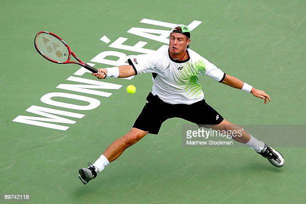 Lleyton Hewitt of Australia returns a shot to Juan Carlos Ferrero of Spain during the Rogers Cup at Uniprix Stadium on August 11 2009 in Montreal...