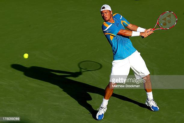 Lleyton Hewitt of Australia returns a shot to Ryan Harrison during the Citi Open at the William H.G. FitzGerald Tennis Center on July 30, 2013 in...