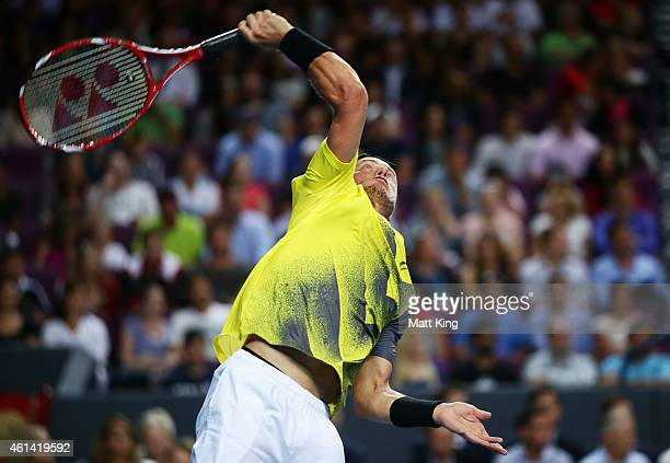 Lleyton Hewitt of Australia serves against Roger Federer of Switzerland during their match at Qantas Credit Union Arena on January 12 2015 in Sydney...