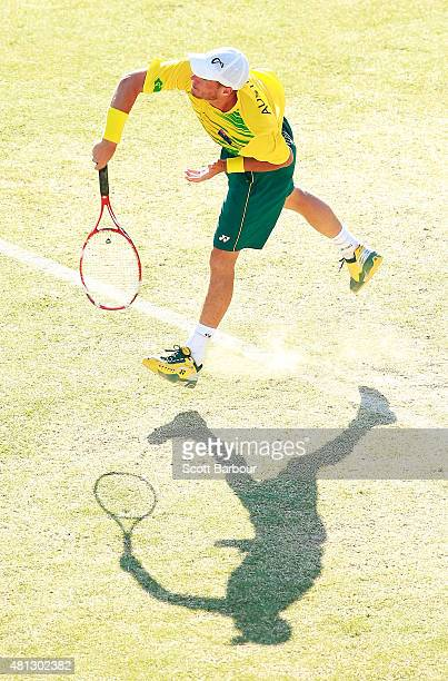 Lleyton Hewitt of Australia serves during the reverse singles match between Lleyton Hewitt of Australia and Aleksandr Nedovyesov of Kazakhstan during...