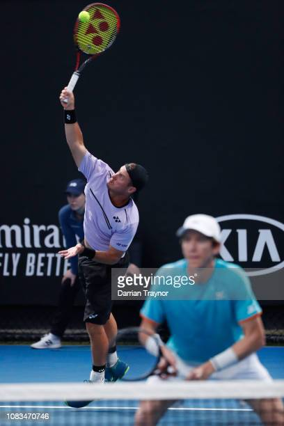 Lleyton Hewitt of Australia serves in his doubles first round match with JohnPatrick Smith of Australia against Marcus Daniell of New Zealand and...