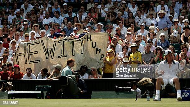 Lleyton Hewitt of Australia sits down at the change of ends as fans show their support during his match against Justin Gimelstob of USA during the...