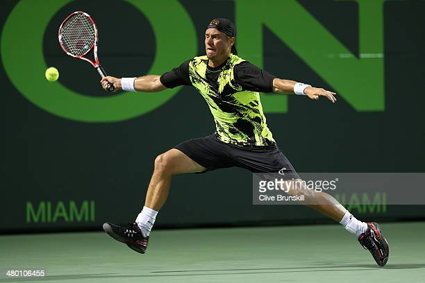 Lleyton Hewitt of Australia stretches to play a forehand against Rafael Nadal of Spain during their second round match during day 6 at the Sony Open...