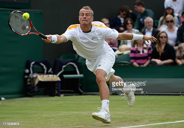 Lleyton Hewitt of Australia stretches to play a forehand during his Gentlemen's Singles second round match against Dustin Brown of Germany on day...