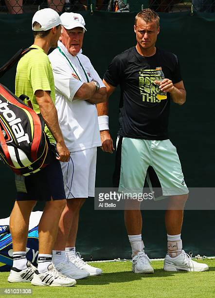 Lleyton Hewitt of Australia talks with coach Tony Roche during a practice session during previews for Wimbledon Championships at Wimbledon on June 22...