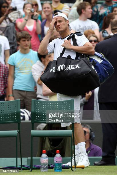 Lleyton Hewitt of Australia walks off court after losing his Gentlemen's Singles first round match against JoWilfried Tsonga of Franceon day two of...
