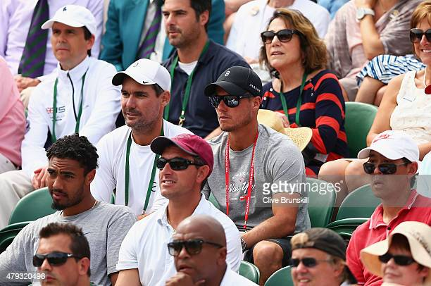 Lleyton Hewitt of Australia watches the Gentlemen's Singles Third Round match between Nick Kyrgios of Australia and Milos Raonic of Canada during day...