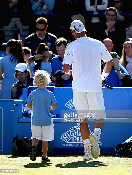 Lleyton Hewitt of Australia with his son Cruz after victory in the Men's Singles quarter final round match against Juan Martin del Potro of Argentina...