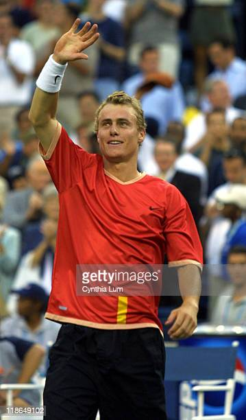 Lleyton Hewitt waves to the crowd after his 76 61 61 victory over Pete Sampras