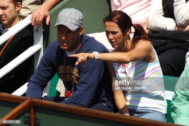 Lleyton Hewitt's wife Rebecca Cartwright watches from the stands