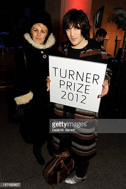 Lliana Bird and Noel Fielding attend the Turner Prize 2012 winner announcement at the Tate Britain on December 3 2012 in London England