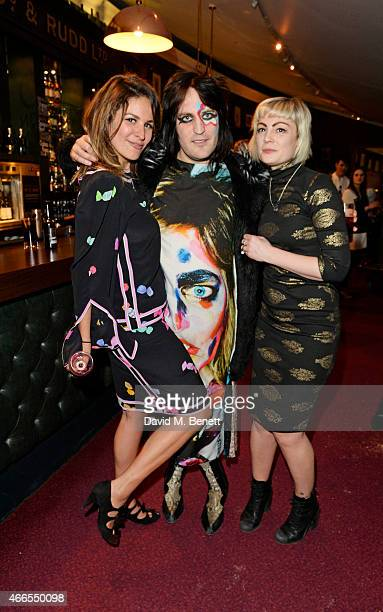"""Lliana Bird, Noel Fielding and Sunta Templeton attend a private view of """"He Wore Dreams Around Unkind Faces"""", an exhibition by Noel Fielding, at the..."""