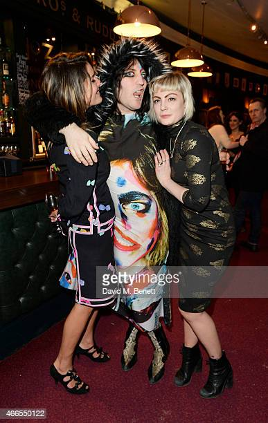 Lliana Bird Noel Fielding and Sunta Templeton attend a private view of He Wore Dreams Around Unkind Faces an exhibition by Noel Fielding at the Royal...