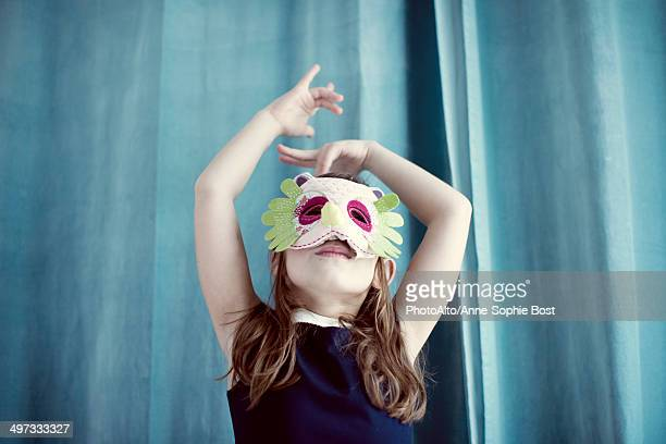 Llittle girl wearing mask
