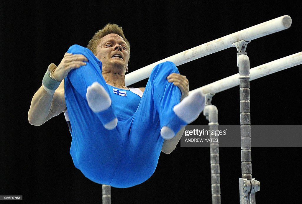 Llkka Kuusela of Finland dismounts from the Parallel Bars during the mens senior qualification round, in the European Artistic Gymnastics Team Championships 2010, at the National Indoor Arena in Birmingham, central England on April 23, 2010.