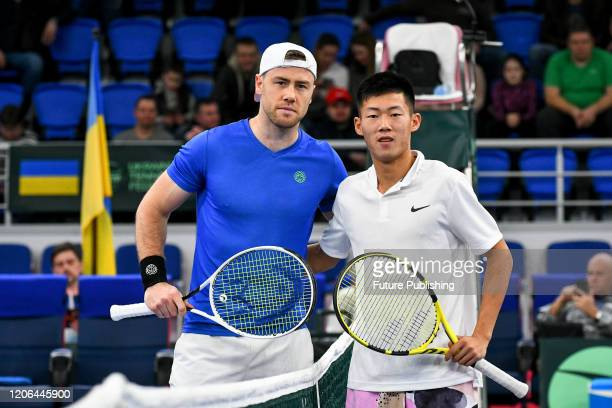 Lllya Marchenko of Ukraine and Chun Hsin Tseng of Chinese Taipei pose fora photo during a match during the Davis Cup World Group I First Round...