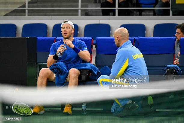 Lllya Marchenko of Ukraine catches a break during a match against Chun Hsin Tseng of Chinese Taipei during the Davis Cup World Group I First Round...